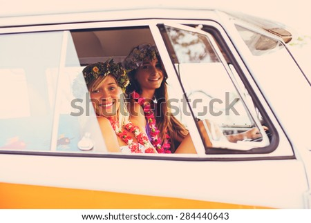 Beach Lifestyle. Beautiful Young Surfer Girls Having Fun Hanging Out in Vintage Surf Van. Best Friends. - stock photo