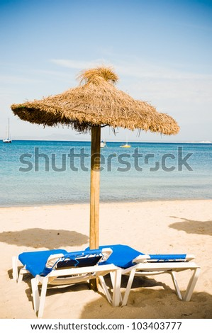 Beach loungers and umbrellas on the beach. Spain. Palma Mallorca - stock photo