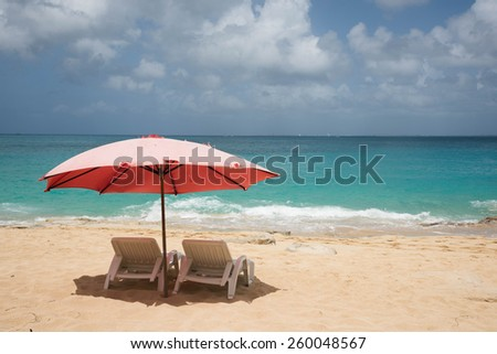 Beach loungers at Baie Rouge, St Martin - stock photo
