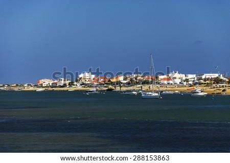 Beach of Faro, Algarve, Portugal - stock photo