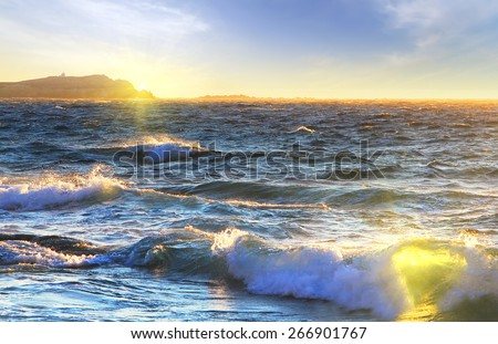 beach of Mediterranian sea at sunrise, Greece. Wave in form of heart. Love concept - stock photo