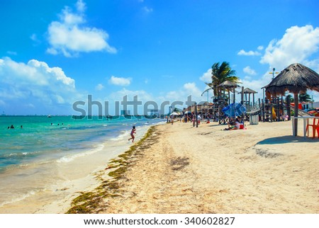 Beach of popular summer resort Cancun in Mexico. Cloudy sky. - stock photo