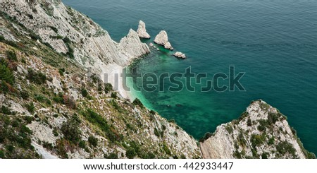 Beach of the two sisters seen from the wolf's step in the park of Mount Conero, Italy - stock photo