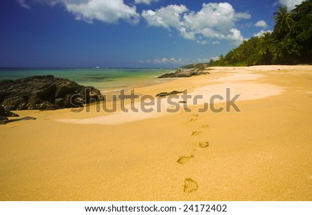 Beach on island koh lanta, thailand with foot steps in soft sand - stock photo