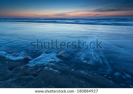 beach on North sea in dusk, Zandvoort aan Zee, North Holland, Netherlands - stock photo