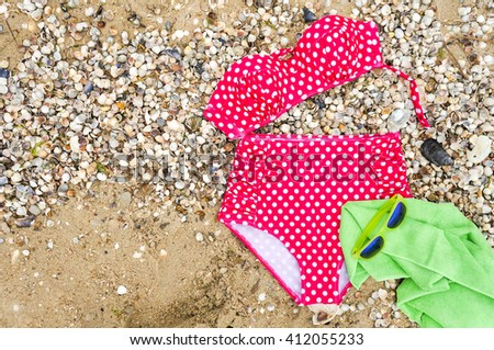 Beach outfit. Summer beach accessories set, sunglasses and beach towel. Beach holiday concept, view from above, top view - stock photo