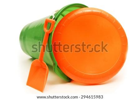 Beach Pail With Frisbee Disc on White/ Heading To The Beach For Fun - stock photo