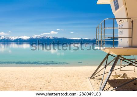 Beach patrol station on the lake against blue sky - stock photo