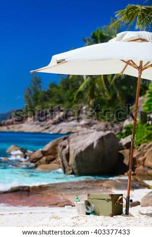 Beach picnic on exotic white sand beach - stock photo