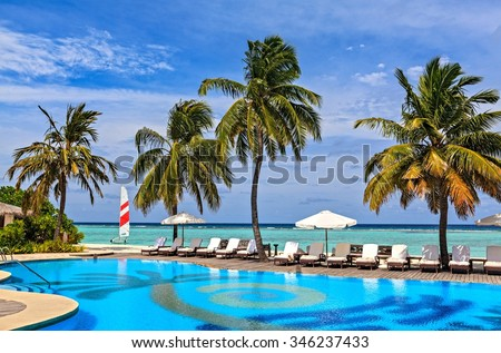 Beach pool in a tropical hotel Palm Beach. Maldives, The Indian Ocean - stock photo