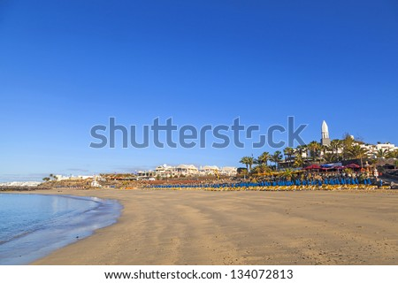beach promenade of Playa Blanca without people in early morning - stock photo