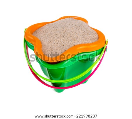 beach sand and bucket isolated on white - stock photo