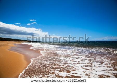 Beach, sand and sky.  Lanai, Hawaii.  Polihua Beach. - stock photo