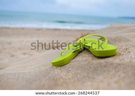 Beach sandals on beach / Early morning of summer  - stock photo