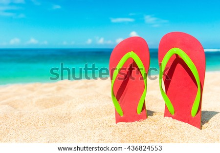 Beach sandals on the sandy coast. Summer holiday and vacation concept. - stock photo