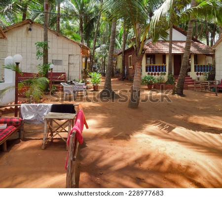 beach scenery with huts in Goa, a state located in India - stock photo