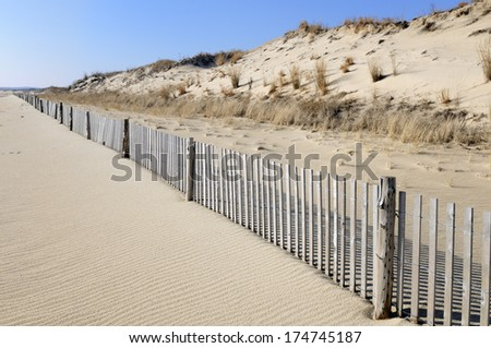 Beach Scenic with Fence Line - stock photo