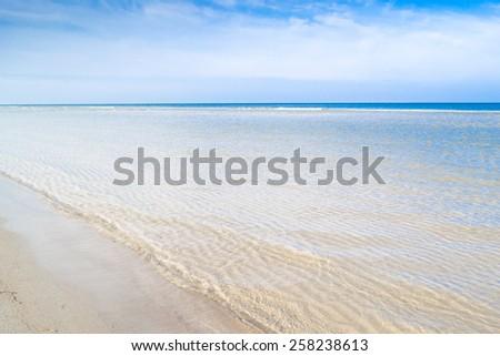 Beach sea view and blue sky, Leba, Baltic Sea, Poland - stock photo