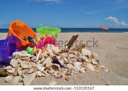 Beach, Shells and Sand Buckets  - stock photo