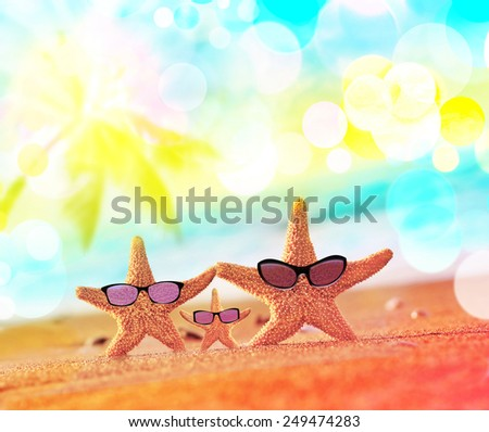Beach. Summer. Starfish in sunglasses  on the seashore. - stock photo