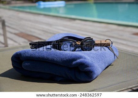 beach, summer, vacation and accessories by the pool - stock photo