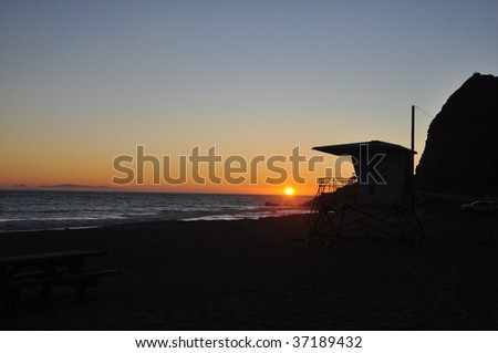 Beach Sunset with Lifeguard Tower - stock photo