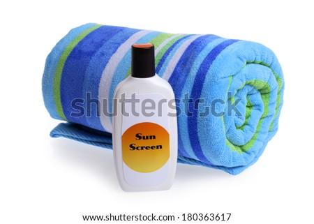 Beach Towel and Sun Screen - stock photo