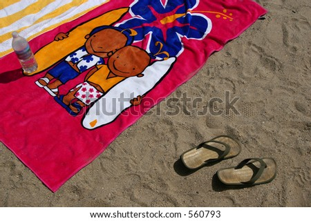 Beach towels and flip-flops at the beach in Ventura, California. - stock photo