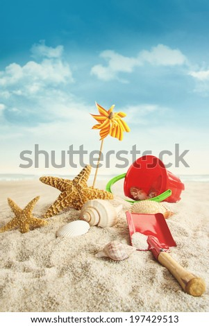 Beach toys on beach against blue sky  - stock photo