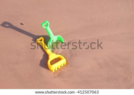 beach toys on the sand. - stock photo
