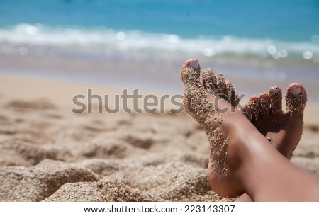 Beach travel - woman legs on sand beach. Travel concept. Vacation - stock photo