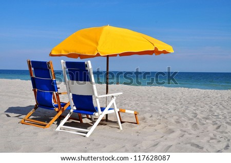 Beach Umbrella and Beach Chairs - stock photo