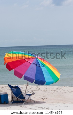 beach umbrella in the sand - stock photo