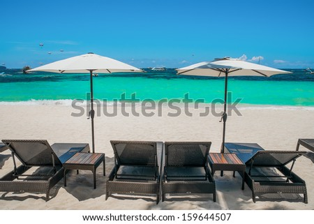 Beach umbrellas and loungers on perfect white beach, Boracay, Philippines - stock photo