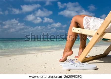 Beach vacation. Hot beautiful woman enjoying looking view of beach - stock photo