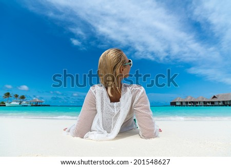 Beach vacation. Hot beautiful woman enjoying looking view of beach ocean on hot summer day. - stock photo