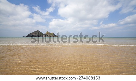 Beach view looking out to sea close from the shoreline. - stock photo