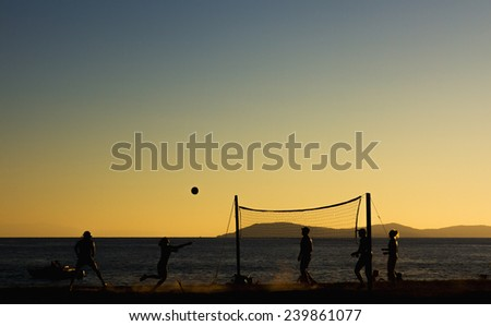 Beach volleyball at sunset. - stock photo