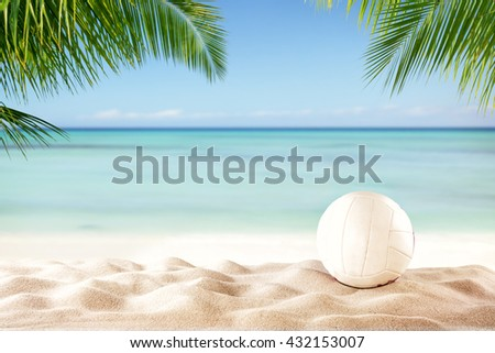 Beach volleyball ball on sandy beach with copyspace for text - stock photo