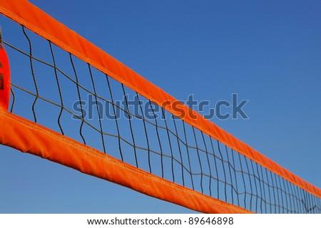 Beach volleyball net against a clear blue sky - stock photo