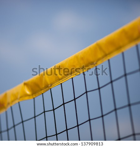 beach volleyball net in sky  - stock photo