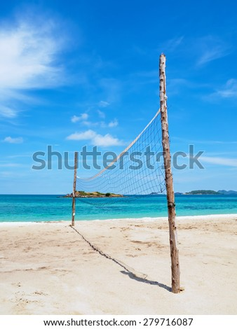 beach volleyball net on the empty beach vacation day - stock photo