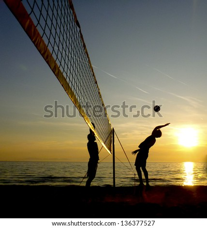 beach volleyball - silhouette - stock photo