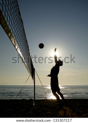 beach volleyball - silhouettes at sunset - stock photo