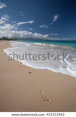 beach, waves and foot steps on the sand / Hawaii, maui - stock photo