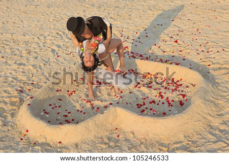 Beach wedding of happy newlywed couple - stock photo