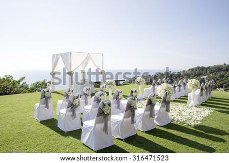 Beach wedding set up, outdoor wedding reception, wedding arch in Thailand - stock photo