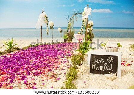 beach wedding venue (focus on text) - stock photo