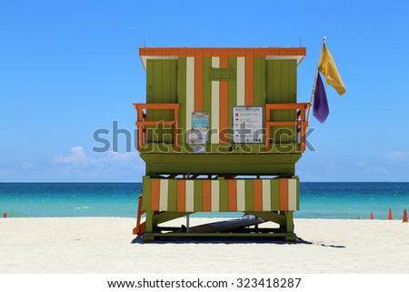 Beach with lifeguard hut facing the ocean - stock photo