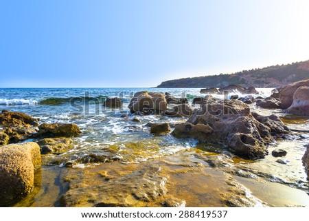 Beach with rocks in Crete, Greece - stock photo